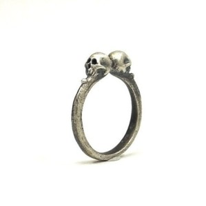 A dainty skull ring doesn't go overboard.  From voodookingdesigns's Etsy shop.