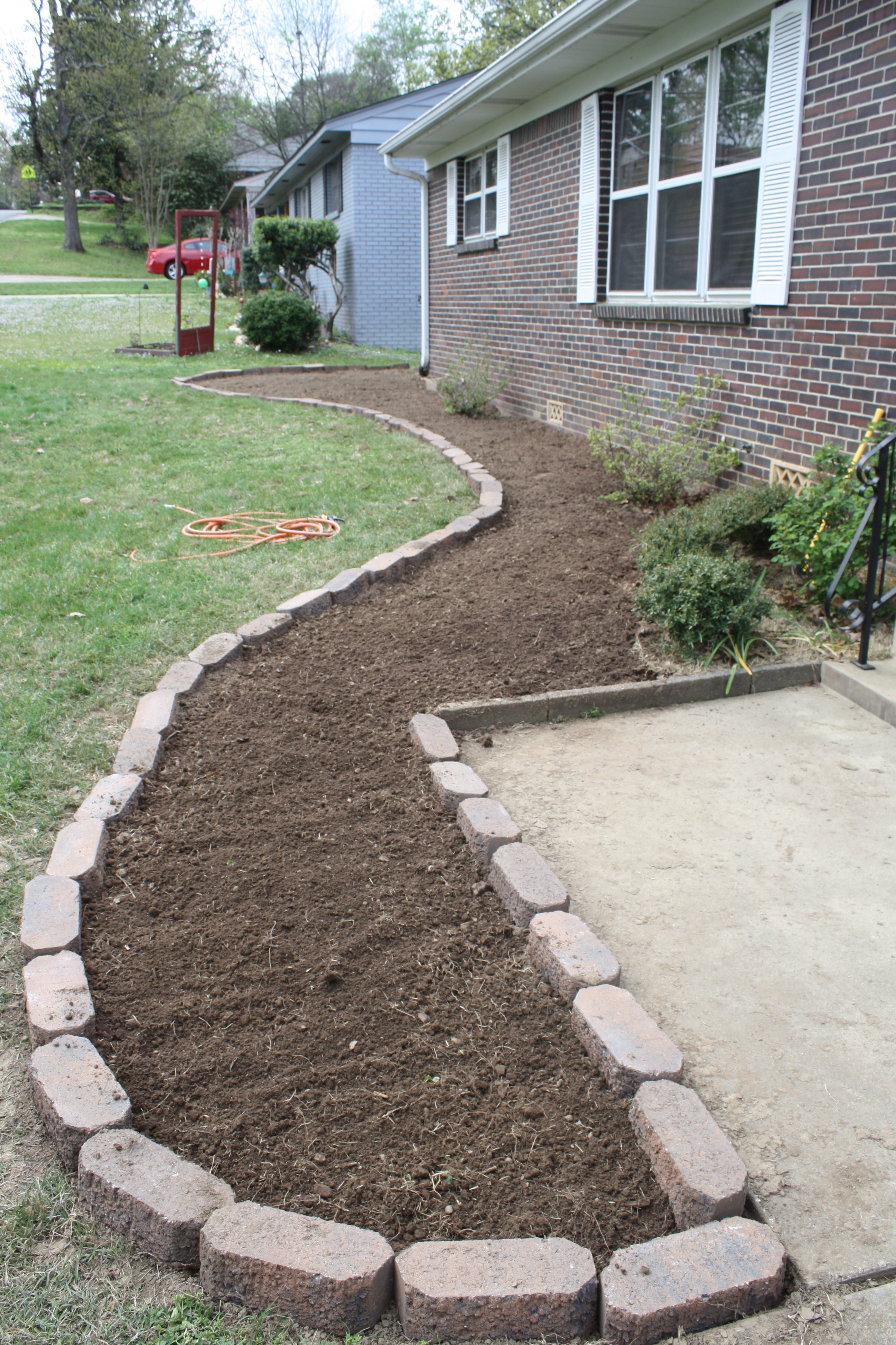 Manscaping phase 1 a guest post from aaron rosemary for Front yard flower bed designs