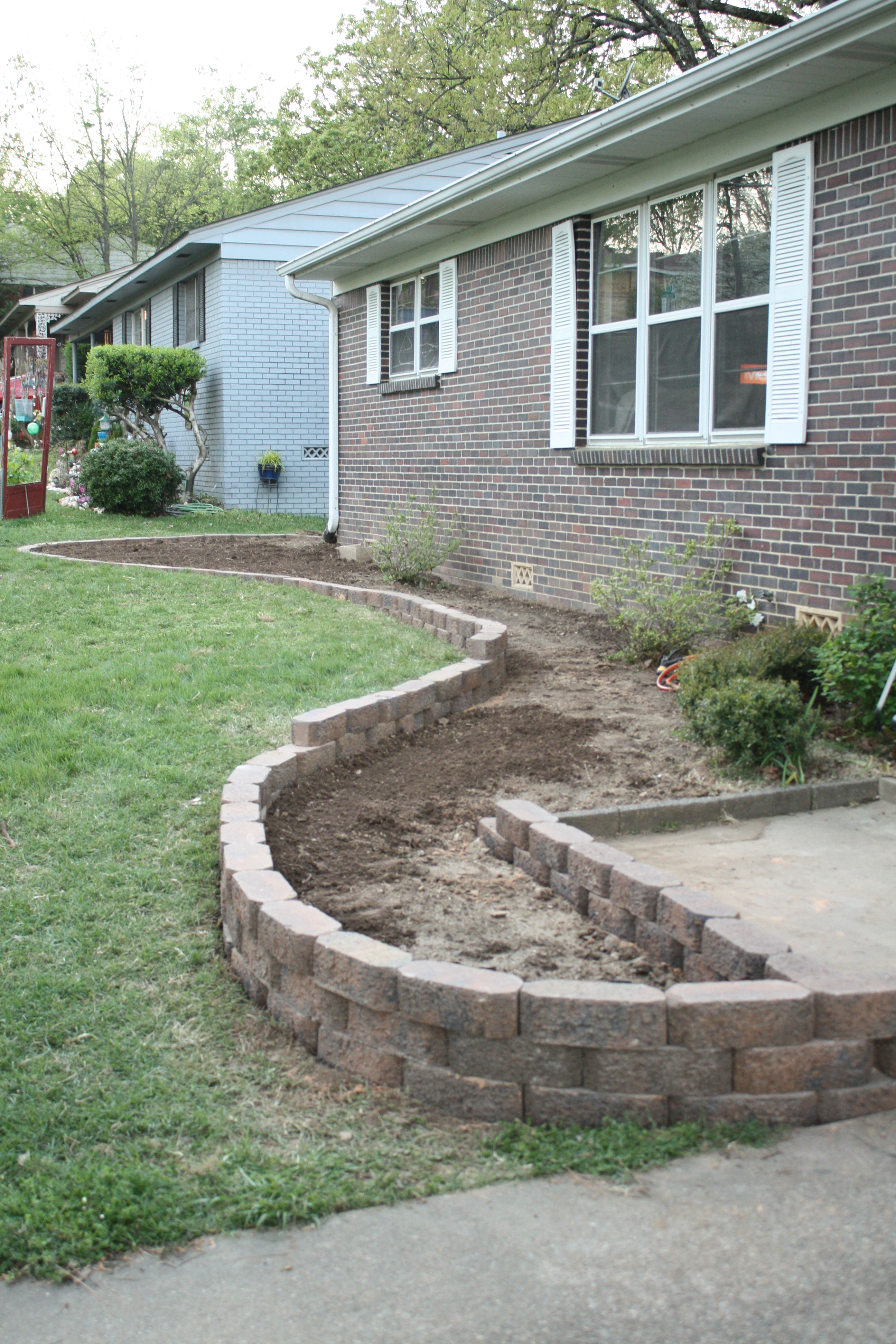Manscaping phase 1 a guest post from aaron rosemary for Raised flower bed ideas front of house